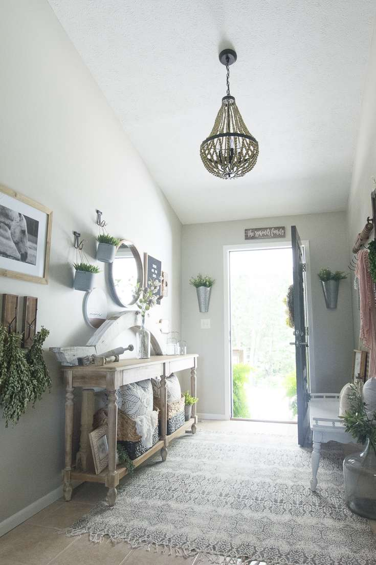 Wood beaded chandelier adds a special touch for a modern farmhouse entryway.