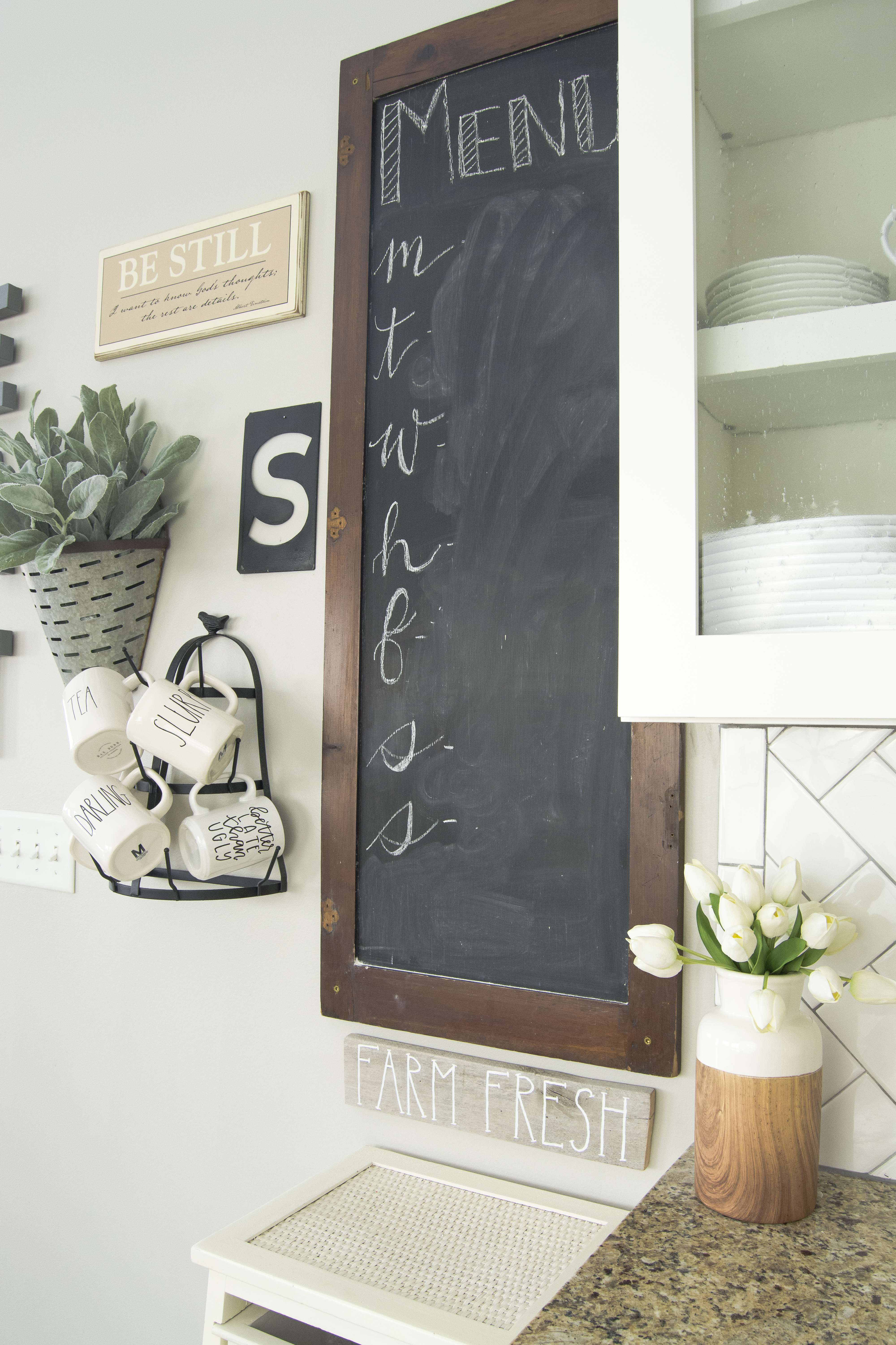 Looking for ways to incorporate signs into your farmhouse style kitchen? Here I show you how I use Be Still and Know signs in my home decor.