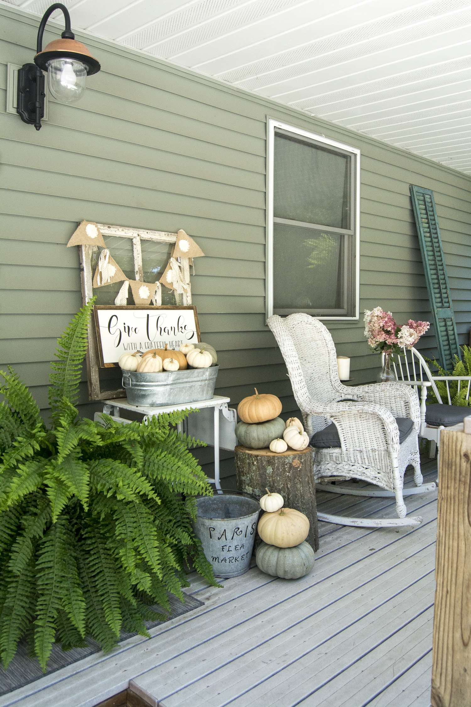 How to style a fall front porch with minimal decor and lots of nature! Grab your coffee and sit a spell on my fall front porch. | www.graceinmyspace.com