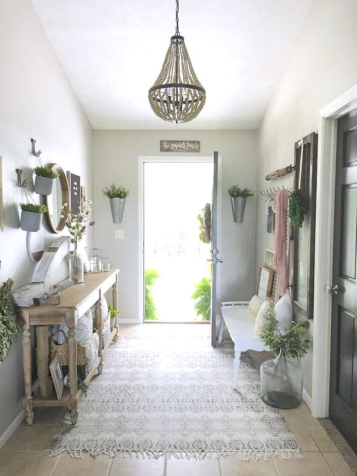 A modern farmhouse entryway update wood beaded chandelier installation