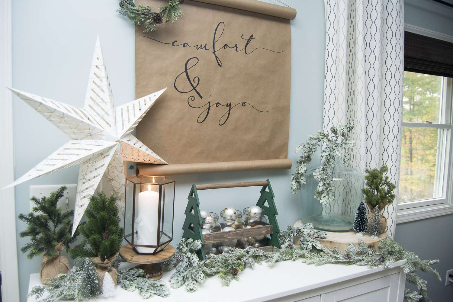 If you're looking for simple and affordable Christmas decor, look no further than this easy DIY Christmas scroll art! This project takes less than 1 hour!
