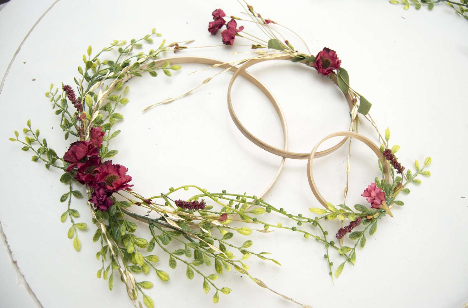 If you're looking for a unique, affordable and simple way to add interest to your home then make sure to try out my easy DIY hoop wreaths tutorial!