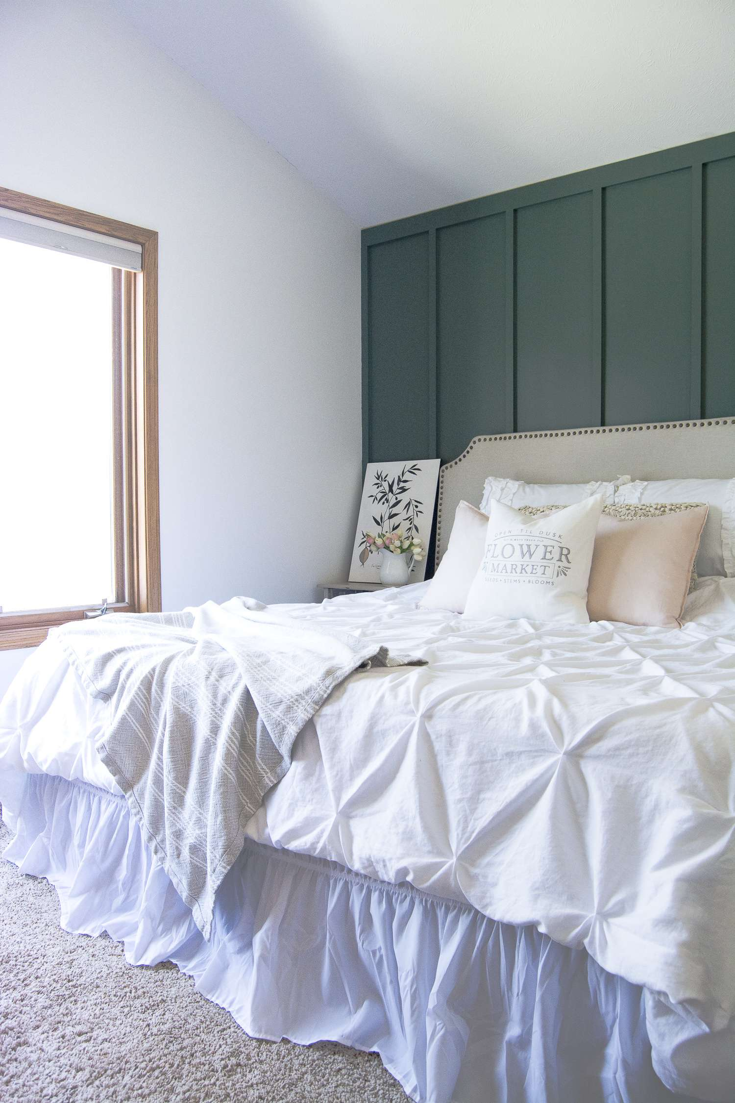 A master bedroom should be your oasis! That is exactly what I created when I installed a modern farmhouse bedroom accent wall. Head to the blog to see my master bedroom retreat and to get the tutorial and paint sources!