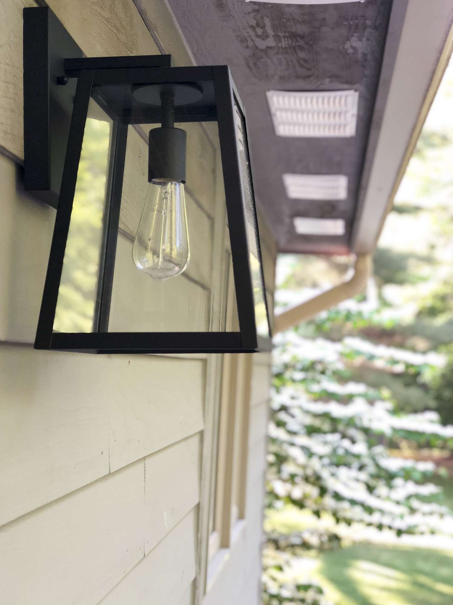 Are you looking for an easy and affordable way to update your home exterior? I modernized our 1990s ranch in one afternoon with affordable modern farmhouse outdoor lighting! Read more to see the transformation!
