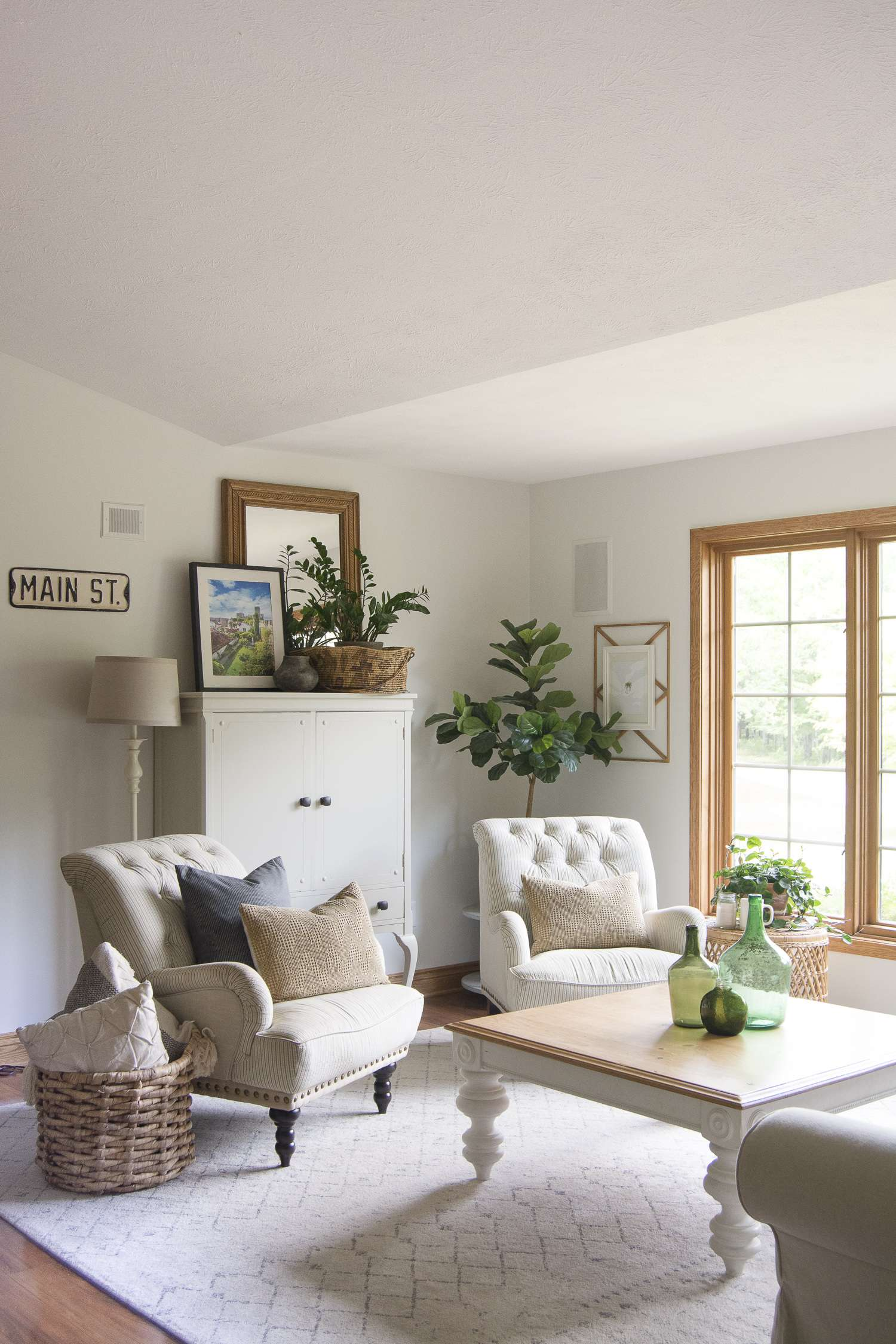 How I transformed a dated living room into a vintage farmhouse decor haven. Come see the before and after for this breathtaking living room update.
