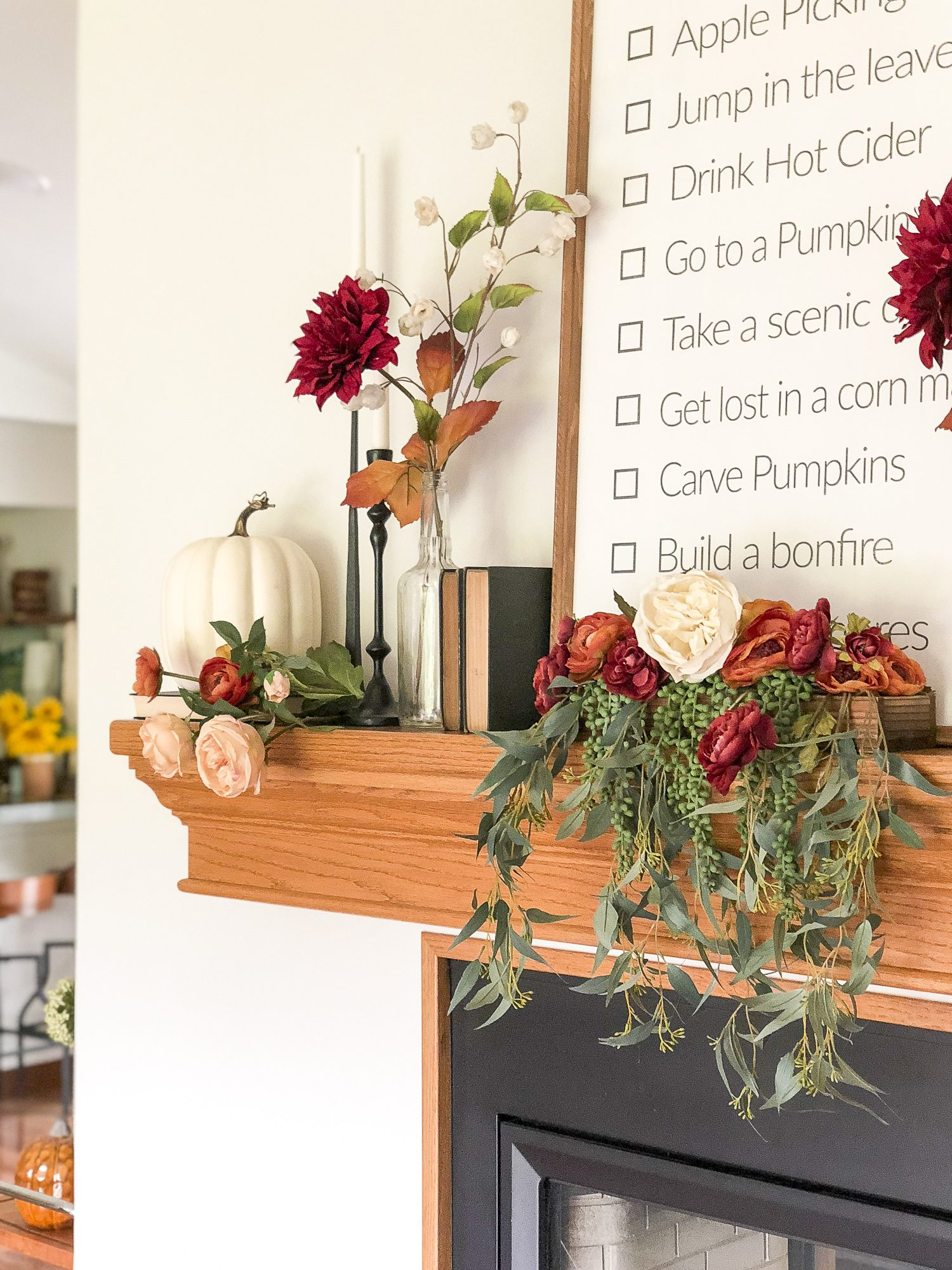 Do you love the vintage farmhouse style? Read more to see how I designed my farmhouse mantel decor with a touch of vintage and romance added in.