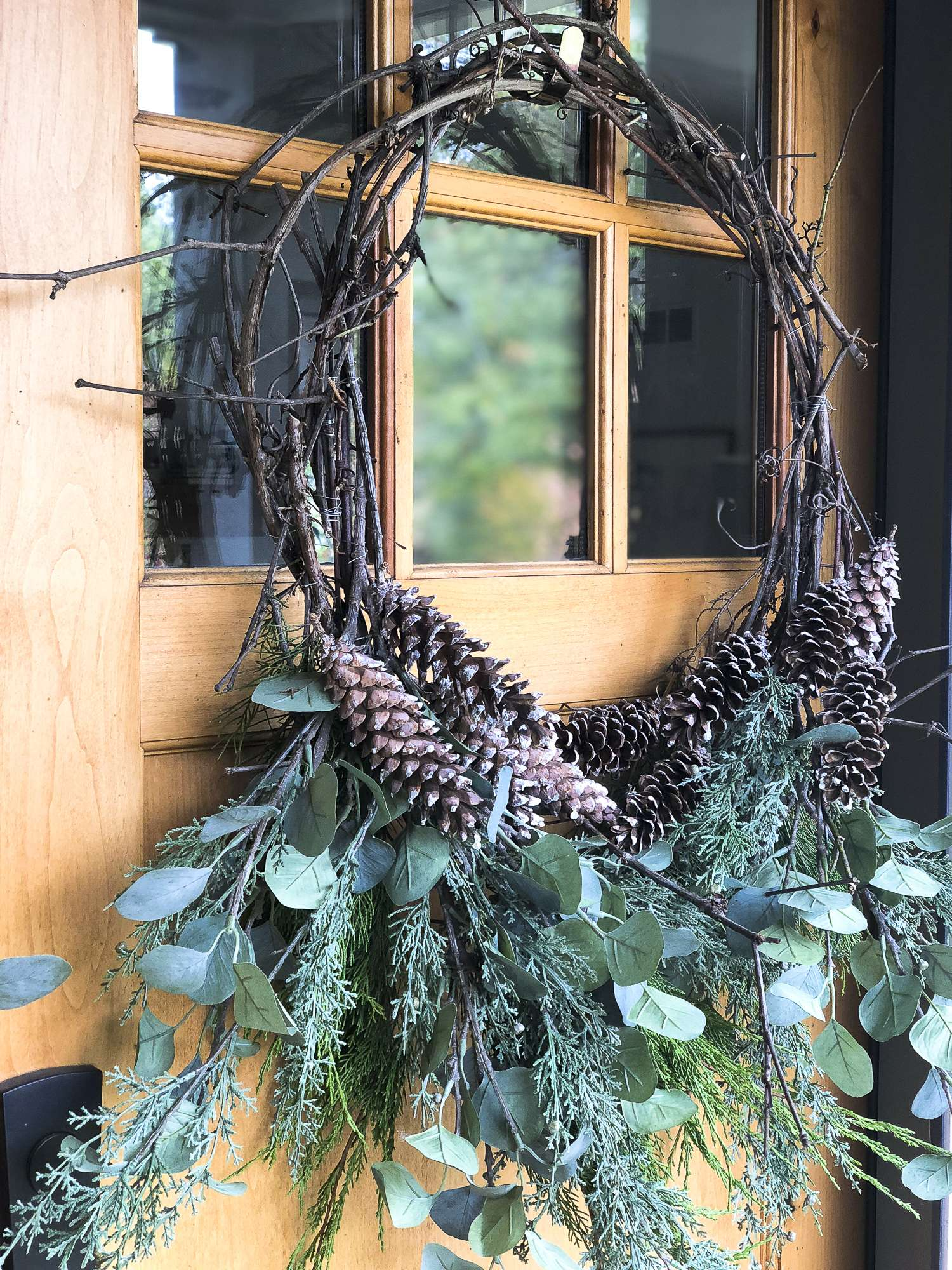Are you looking for an affordable Christmas wreath? Make your own! Click for a tutorial on how to make a DIY Christmas grapevine wreath. #christmaswreath