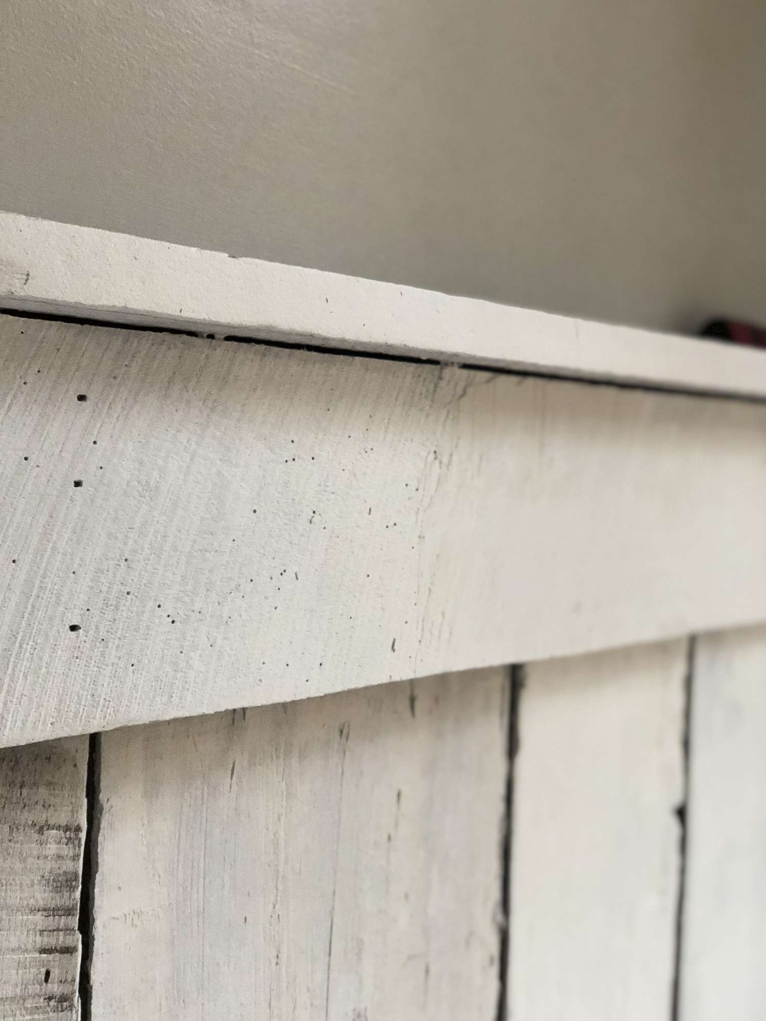 Come see how I took a rustic barnwood wall and transformed it into a more modern accent in our basement remodel for less than $40! #barnwoodwall #diyproject #basementremodel