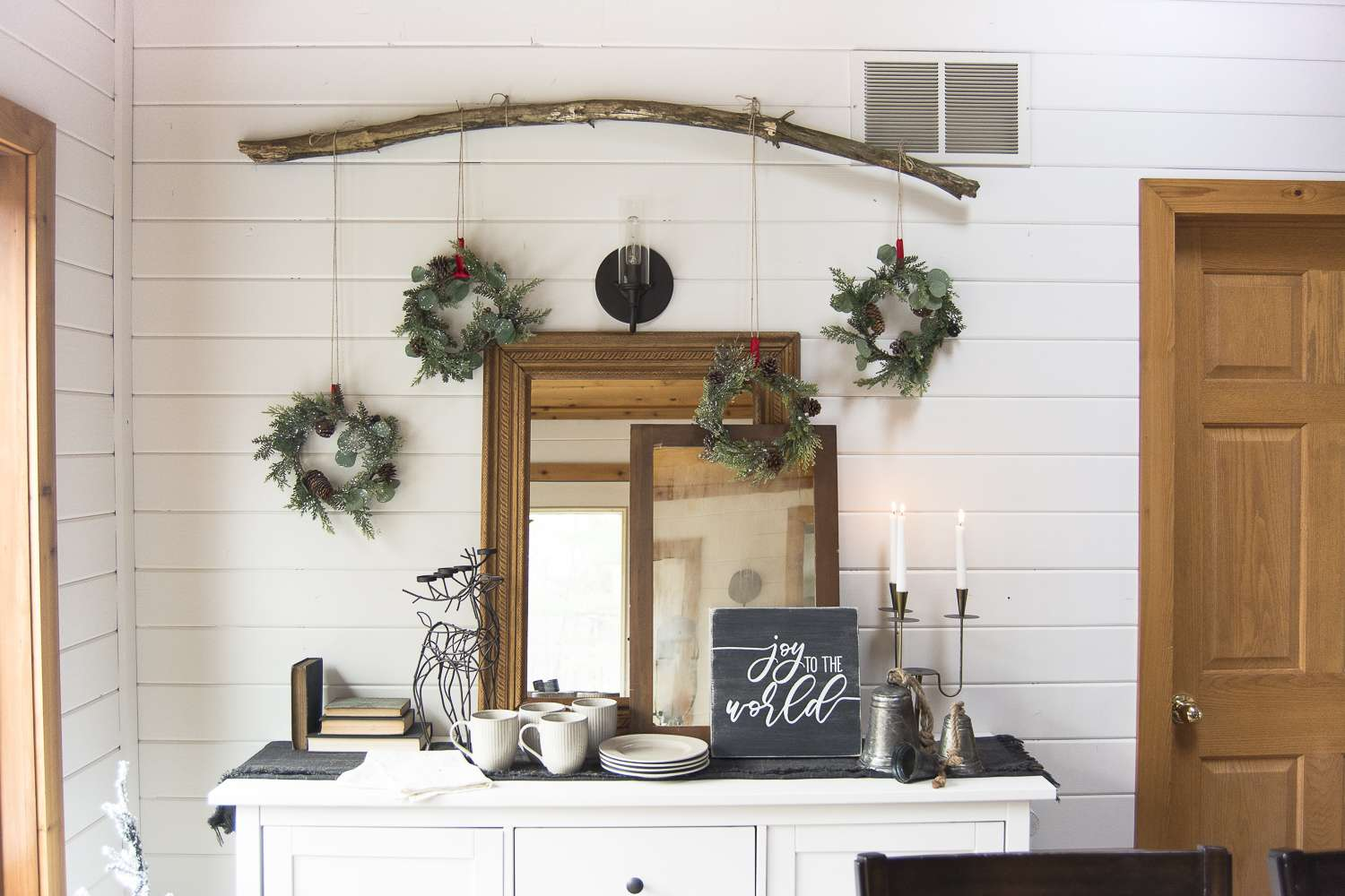 Vintage Christmas decorations are a beautiful addition to your Christmas decor. See how I styled my vintage decor alongside a DIY wreath wall! #vintagechristmasdecorations #christmasdecor #christmaswreath