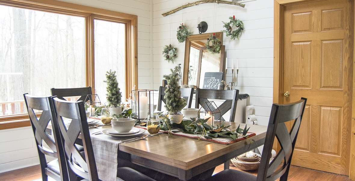 Are you planning a holiday get together? No need to buy Christmas dishes! Here are a few tips on how to use everyday dishes for your holiday table decor. #holidaytabledecor #christmasdecor