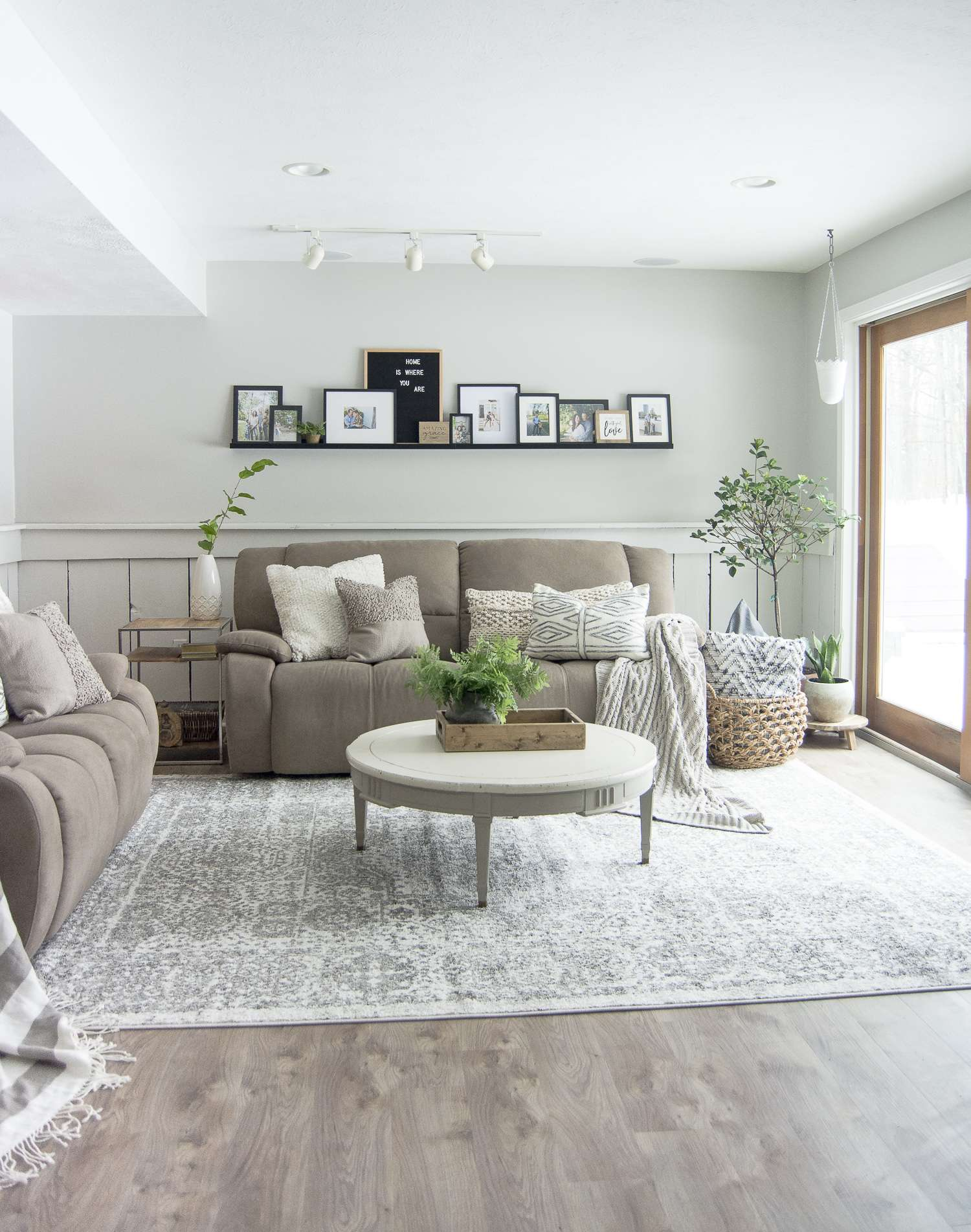 Do you struggle to keep your family room pretty and practical? Today I'm sharing my family room design and how I make it work for an active family of four. #fromhousetohaven #familyroomdesign #livingroom #homedecor