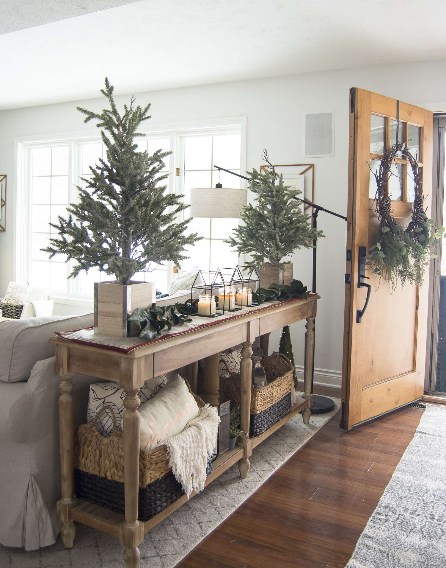 Do you have a small entryway? Today I'm sharing easy tricks and tips to style an entry with simple Christmas entryway decor. #entrywaydecor #christmasdecor #simplechristmasdecor #fromhousetohaven
