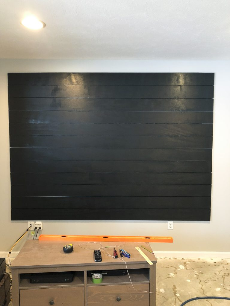This DIY tutorial gives you the basic steps to create a shiplap accent wall! Complete this easy accent wall in one day for an easy way to heighten design. #fauxshiplap #shiplapaccent #fromhousetohaven