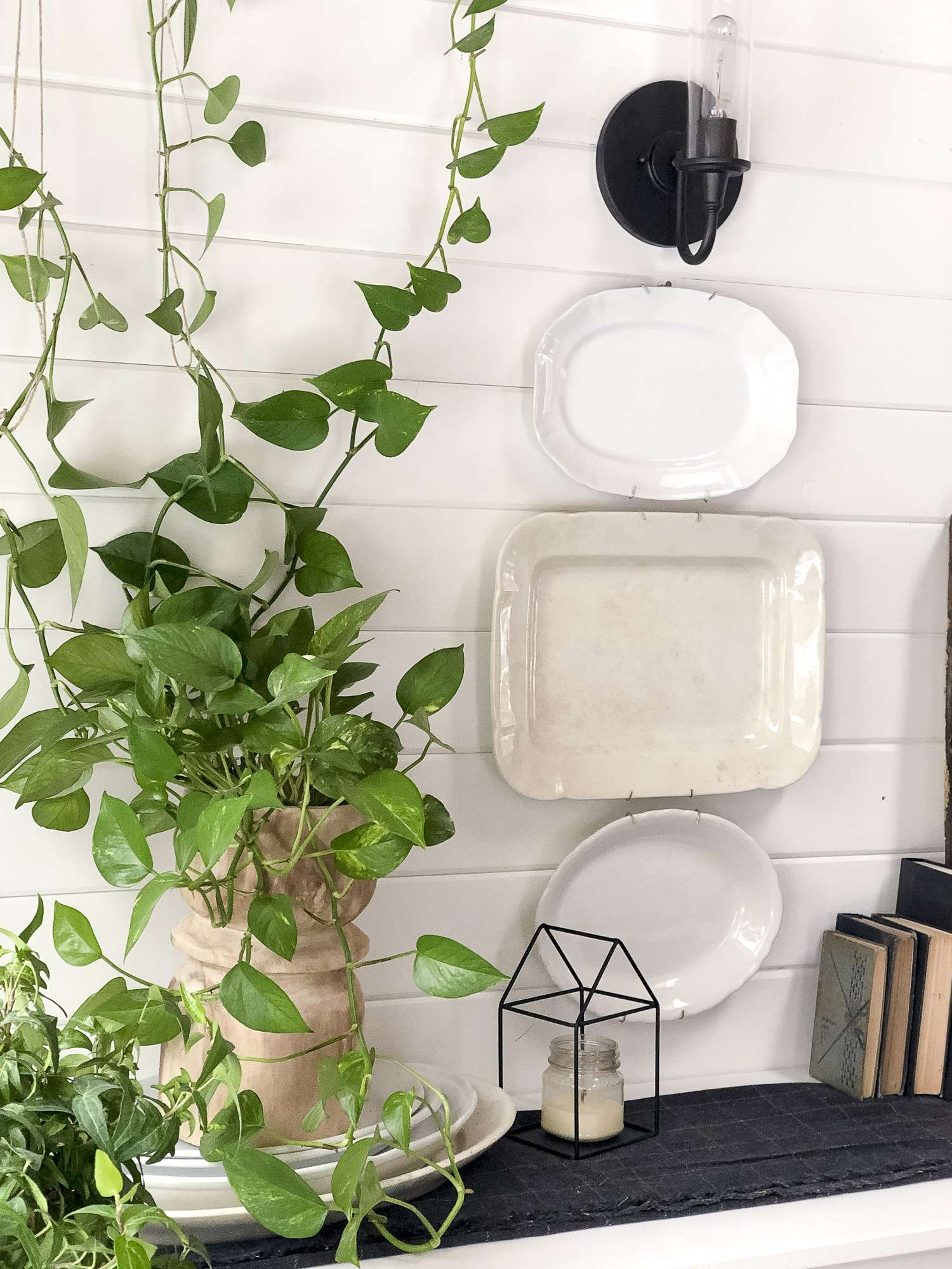 Are you looking for unique ways to warm up your winter decor? Read more about how I created this vertical garden with my winter buffet decor. #fromhousetohaven #verticalgarden #modernfarmhouse #plantlady