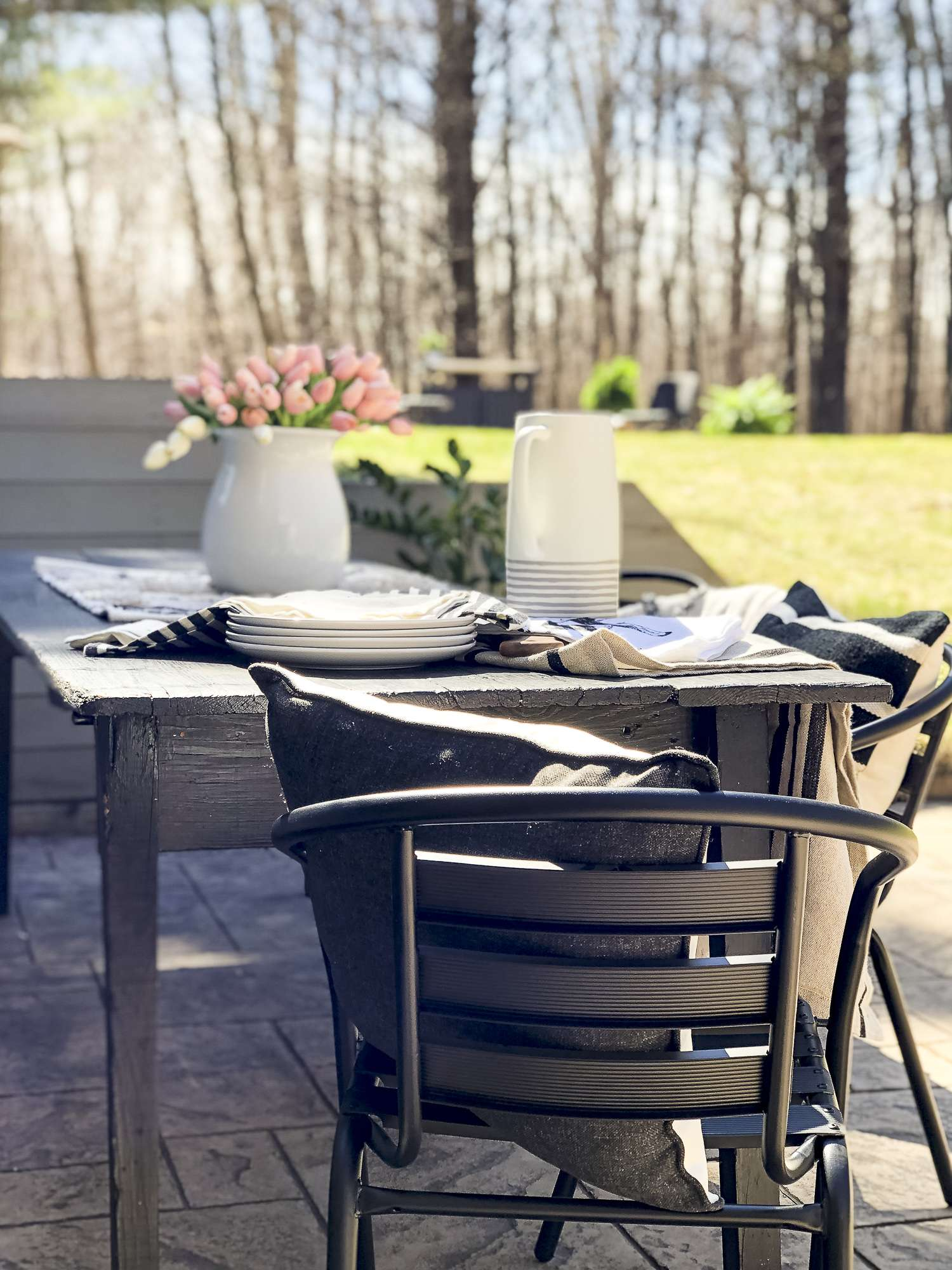 Are you excited for outdoor entertaining? Today I'm sharing my stamped concrete fire pit design plan as I gear up for the warm weather season! #fromhousetohaven #stampedconcrete #patiodesign #firepit