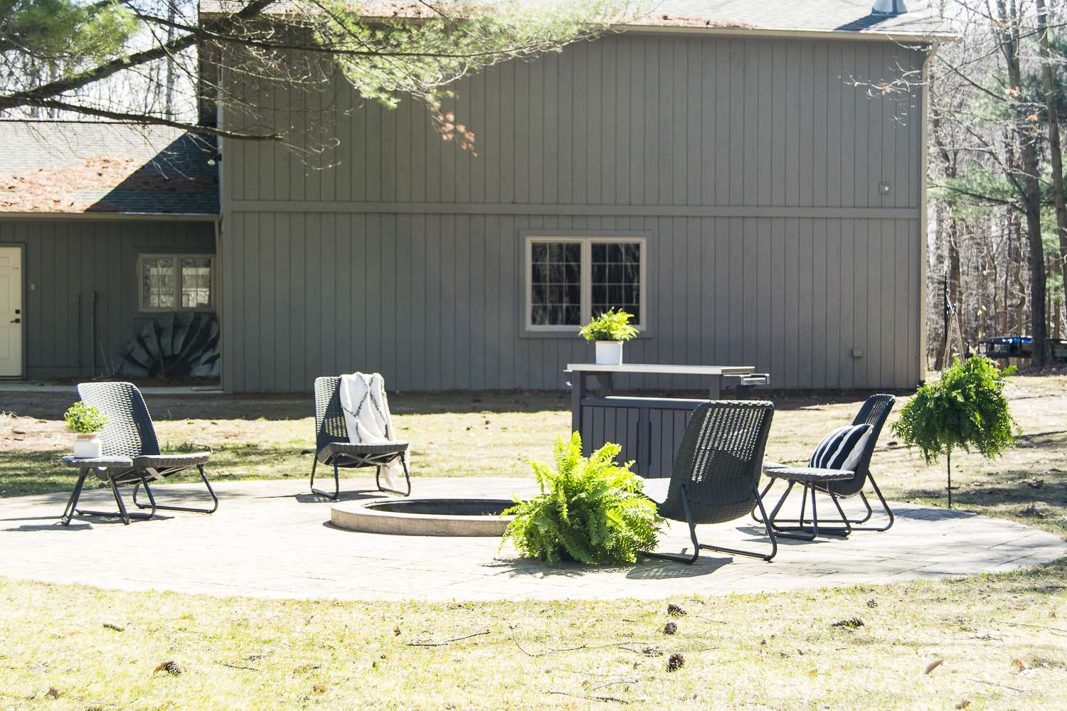 Are you excited for outdoor entertaining? Today I'm sharing my stamped concrete fire pit design plan as I gear up for the warm weather season! #fromhousetohaven #stampedconcrete #patiodecor