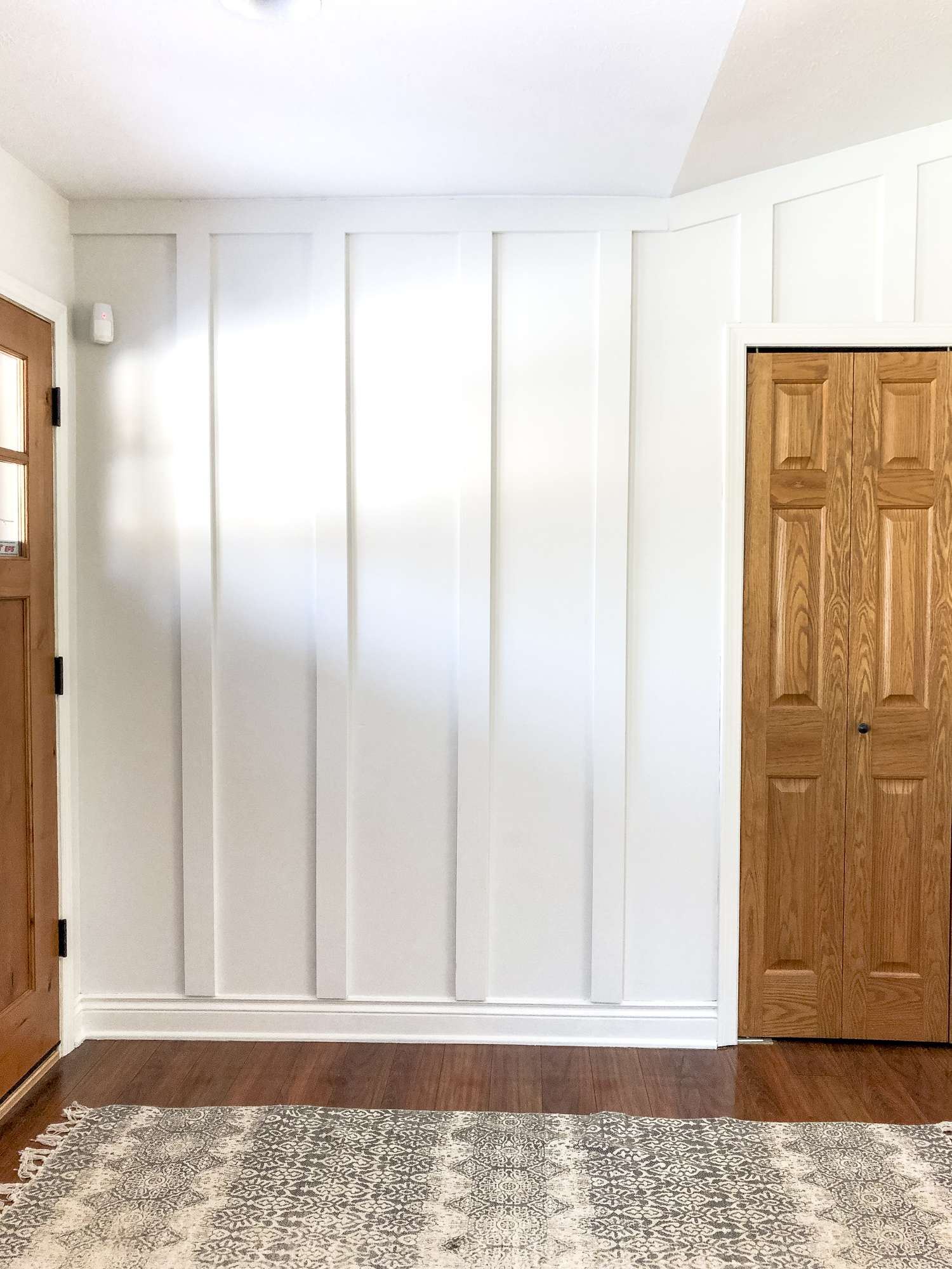 Board and batten is an easy and affordable way to create a custom look! Here is a full tutorial for how to install board and batten as an accent wall! #fromhousetohaven #boardandbatten #accentwall