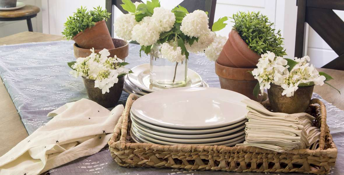 Are you looking for a themed summer tablescape idea? Here is a simple garden party summer tablescape that is effortless and beautiful. #fromhousetohaven #summerdecor #summertablescape #gardenparty