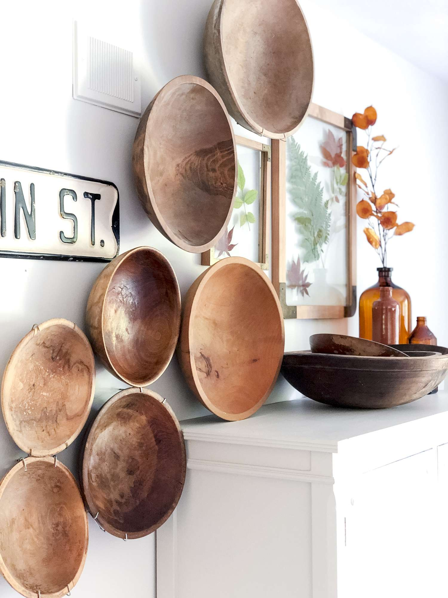 Vintage wooden bowls hanging on a wall as art.