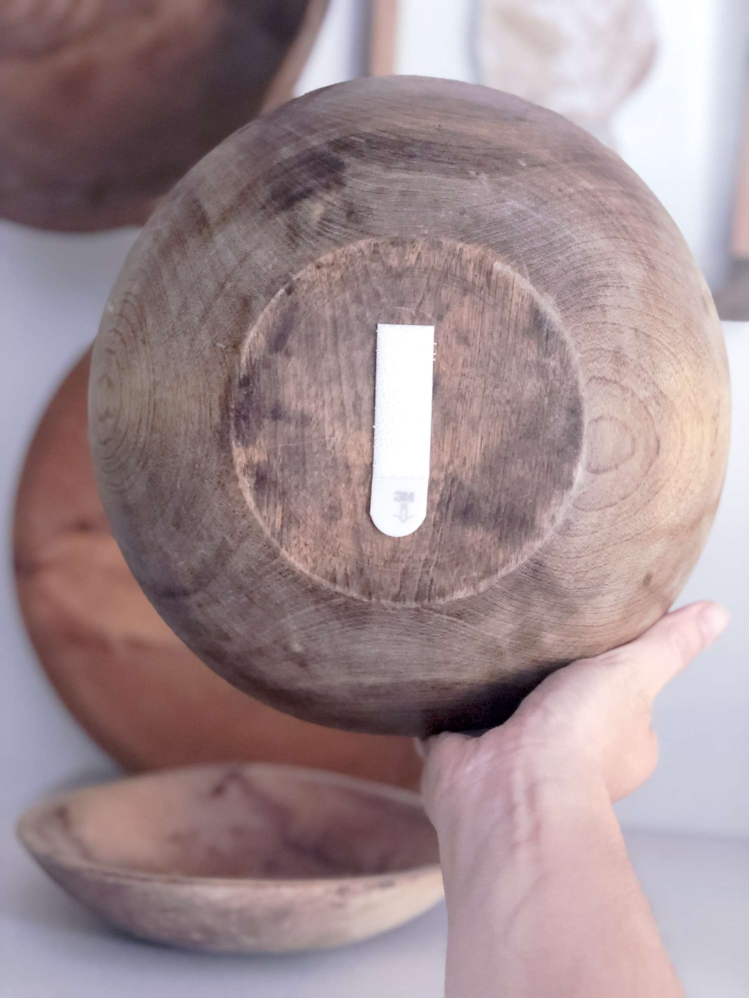 Hanging a wood bowl with command strips.