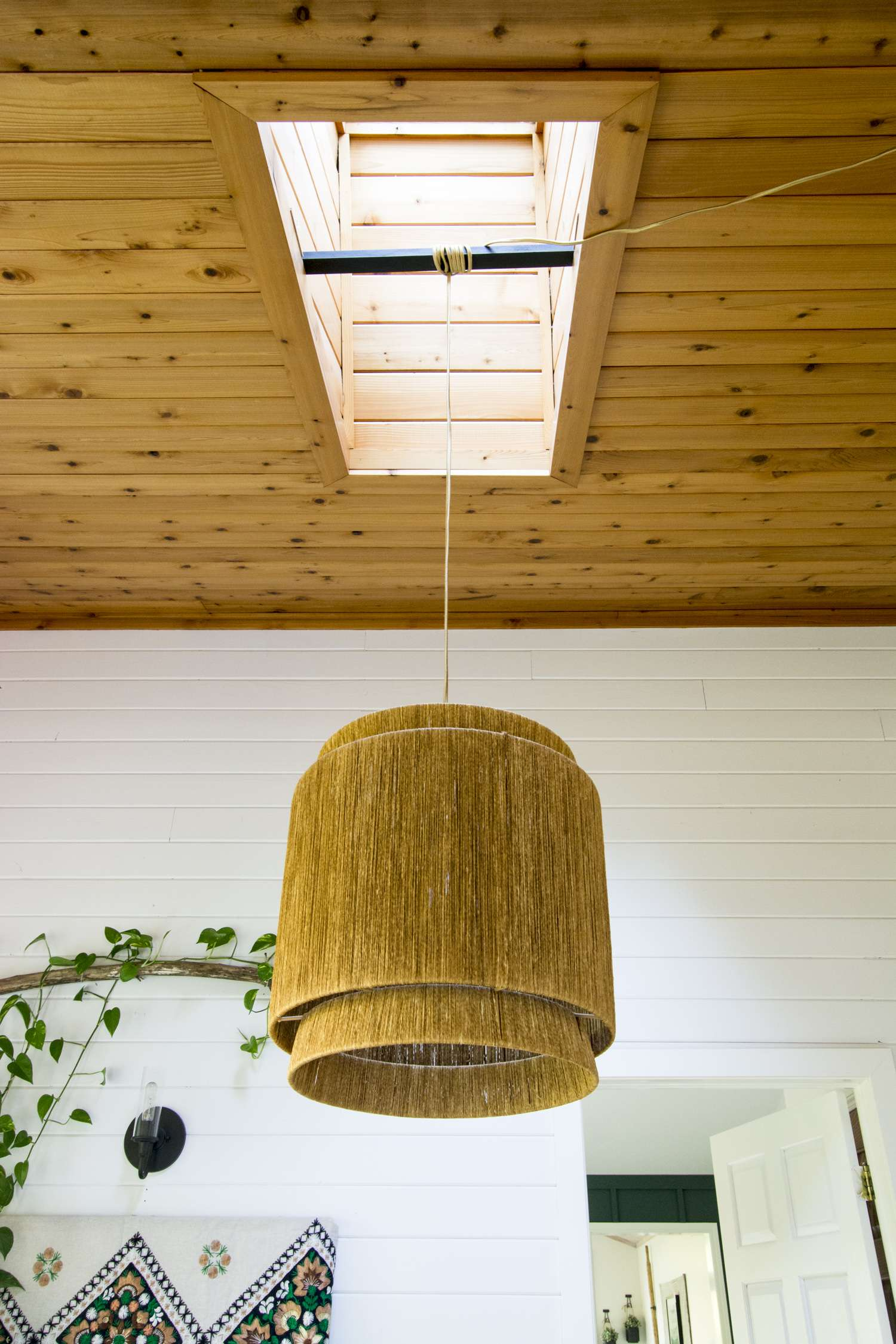 Hanging a pendant light from a skylight.