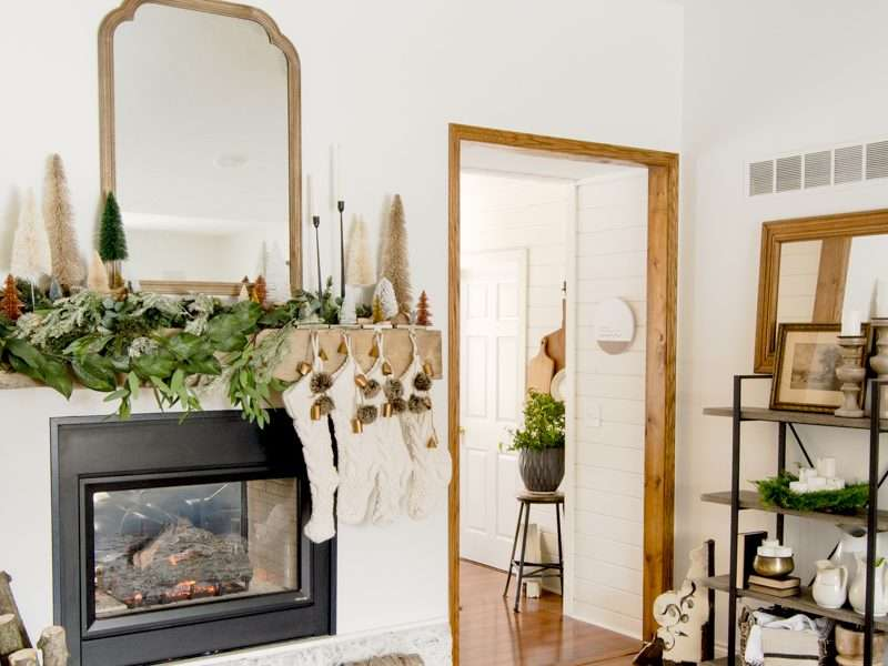 Layering Christmas Mantel Garland In An Asymmetrical Design