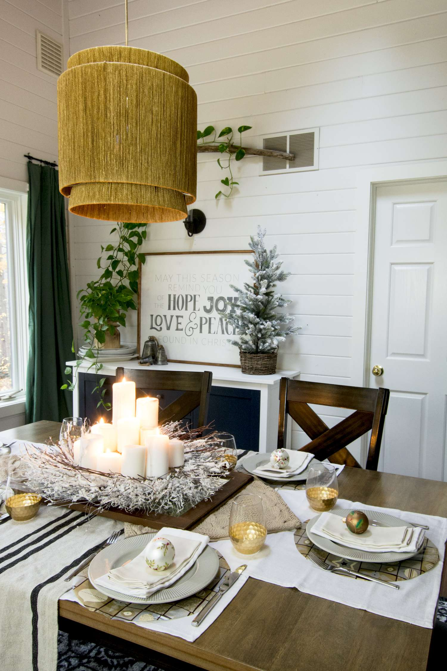 Modern farmhouse dining room decorated for Christmas.