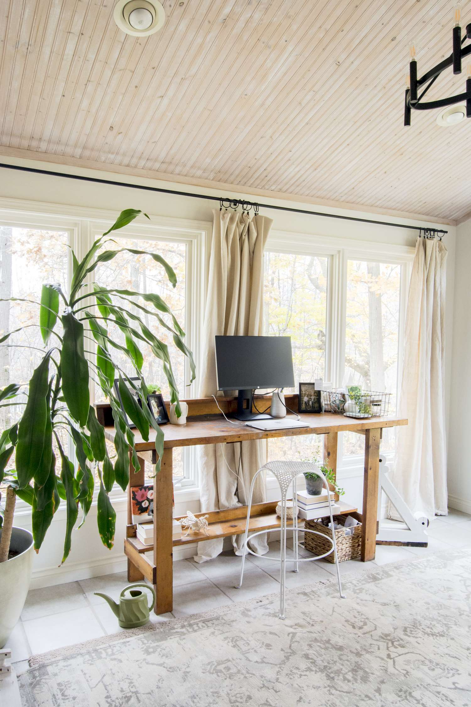 Home office with drop cloth curtains.