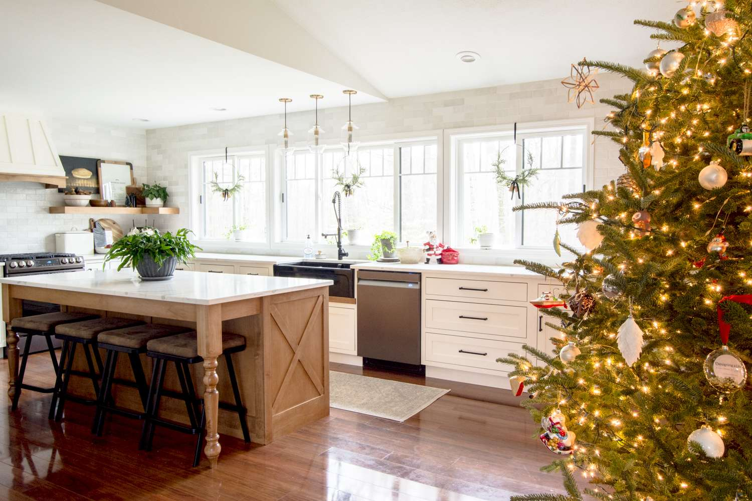 Modern farmhouse kitchen decorated for Christmas.