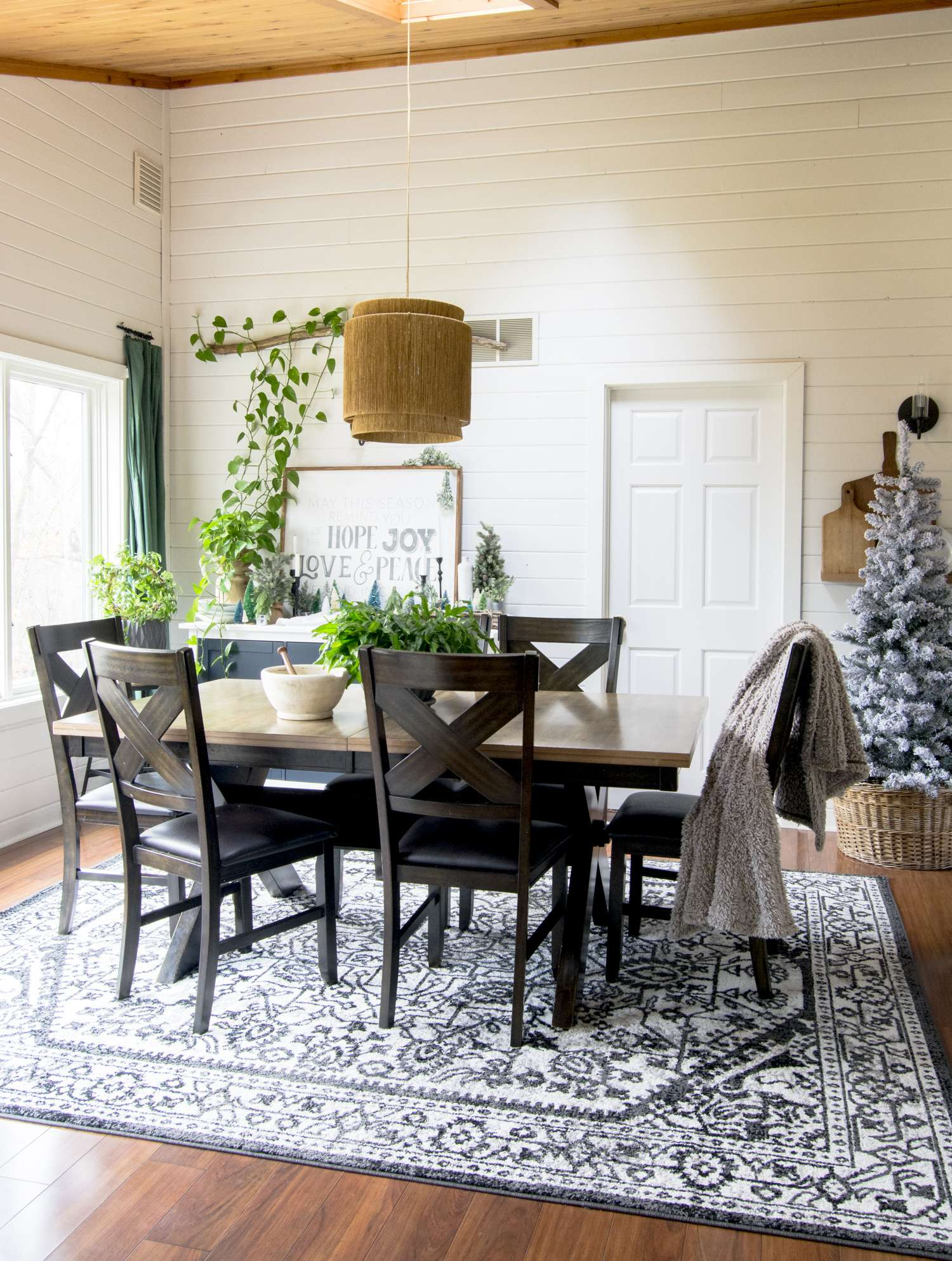 Modern farmhouse dining room styled for Christmas.