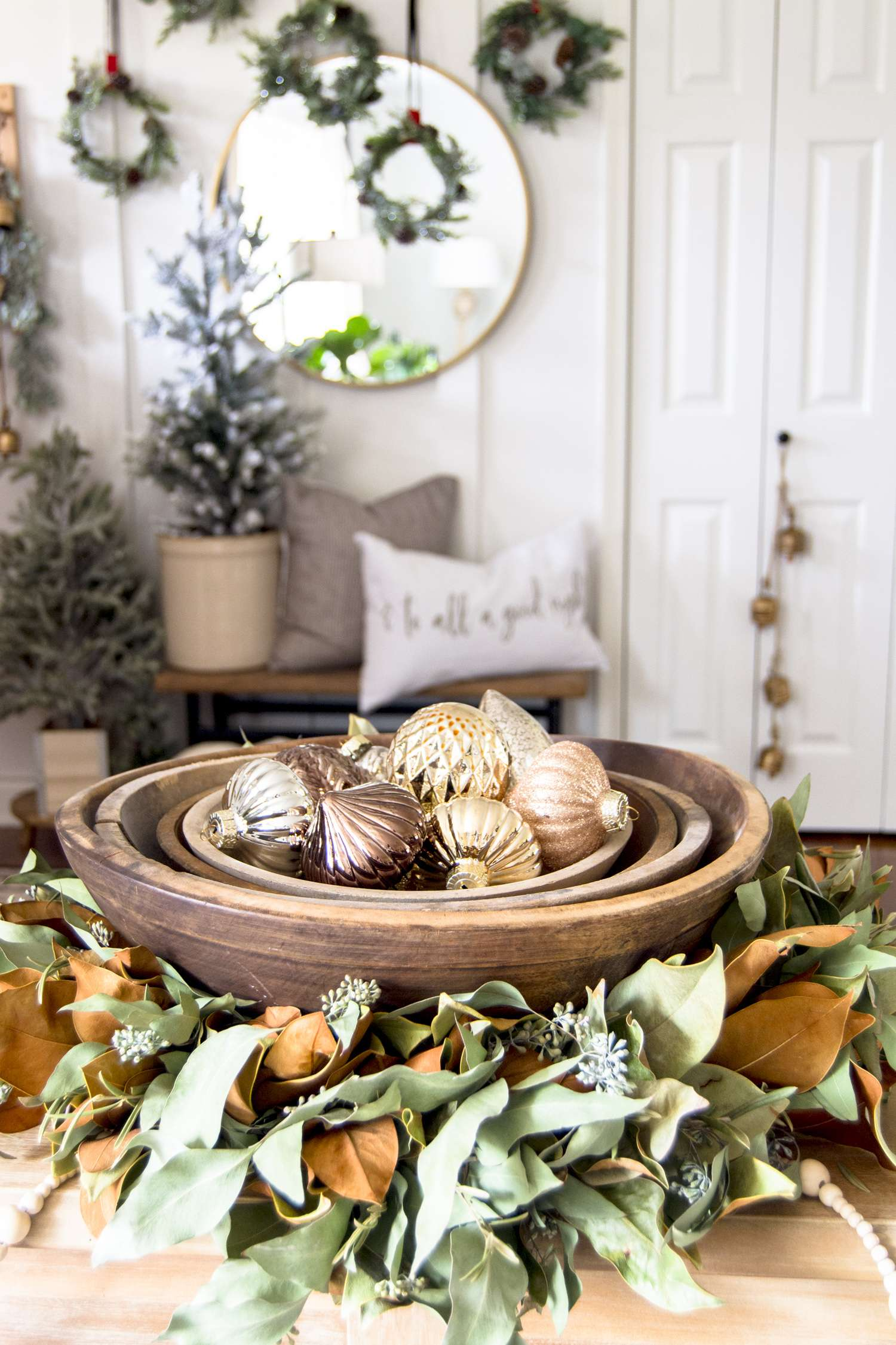 Glass Christmas ornaments in a vintage wood bowl.