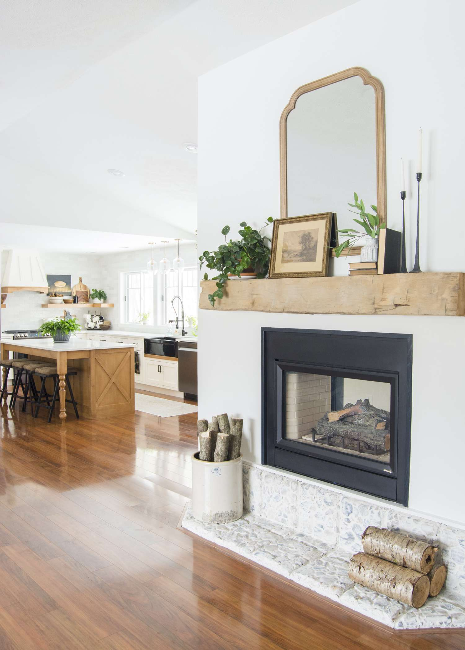 Barn beam mantel styled with modern farmhouse mantel decor.