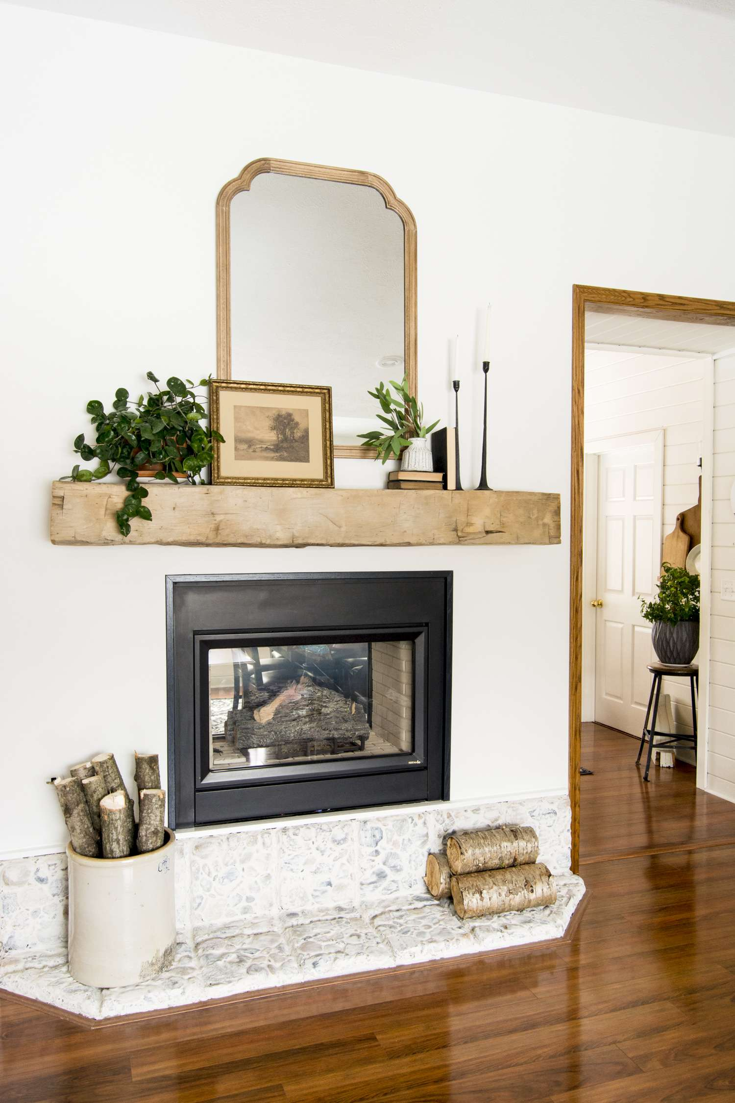 Modern farmhouse barn beam mantel decor.