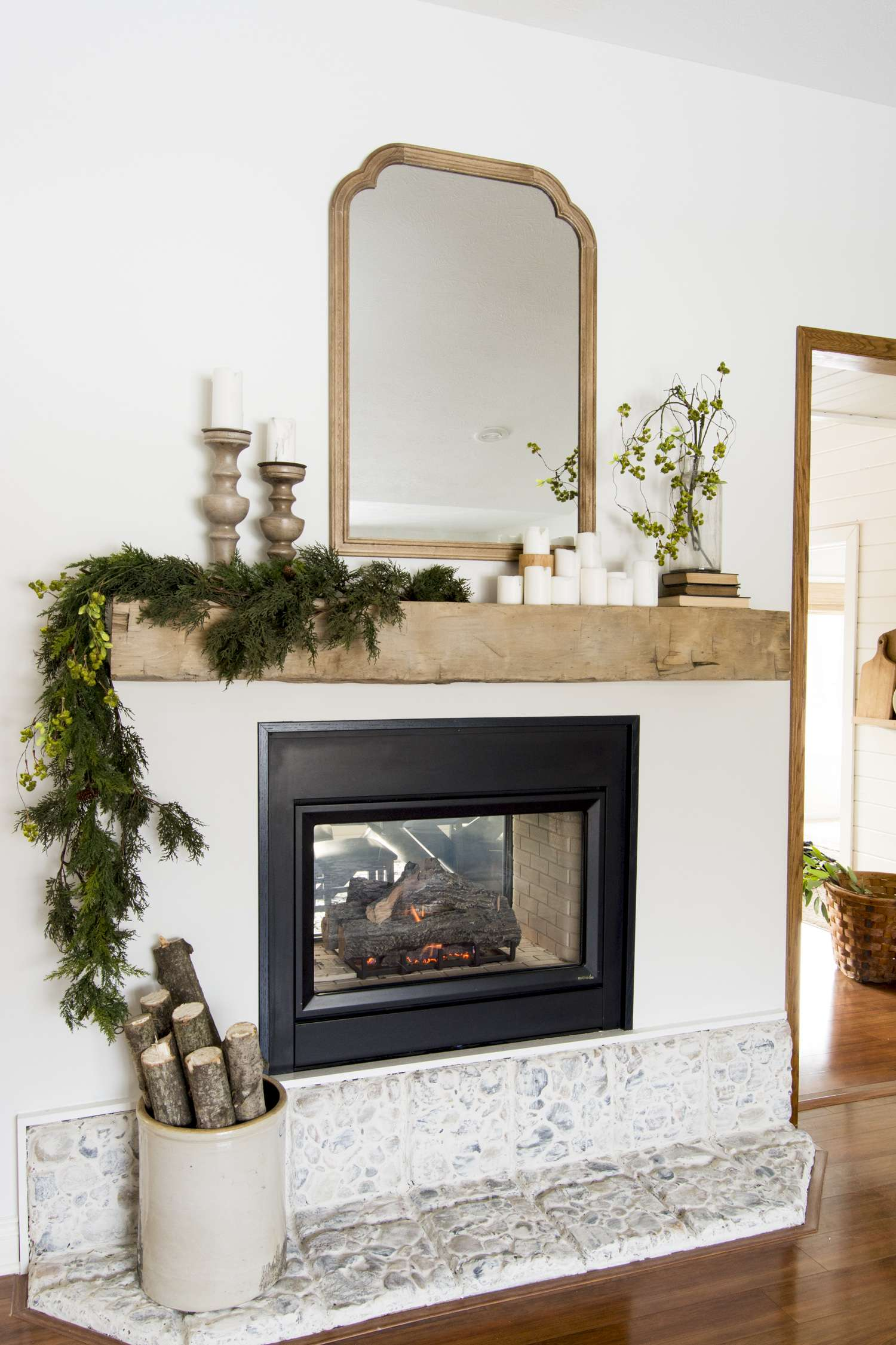 Cozy cottage style fireplace mantel decor.