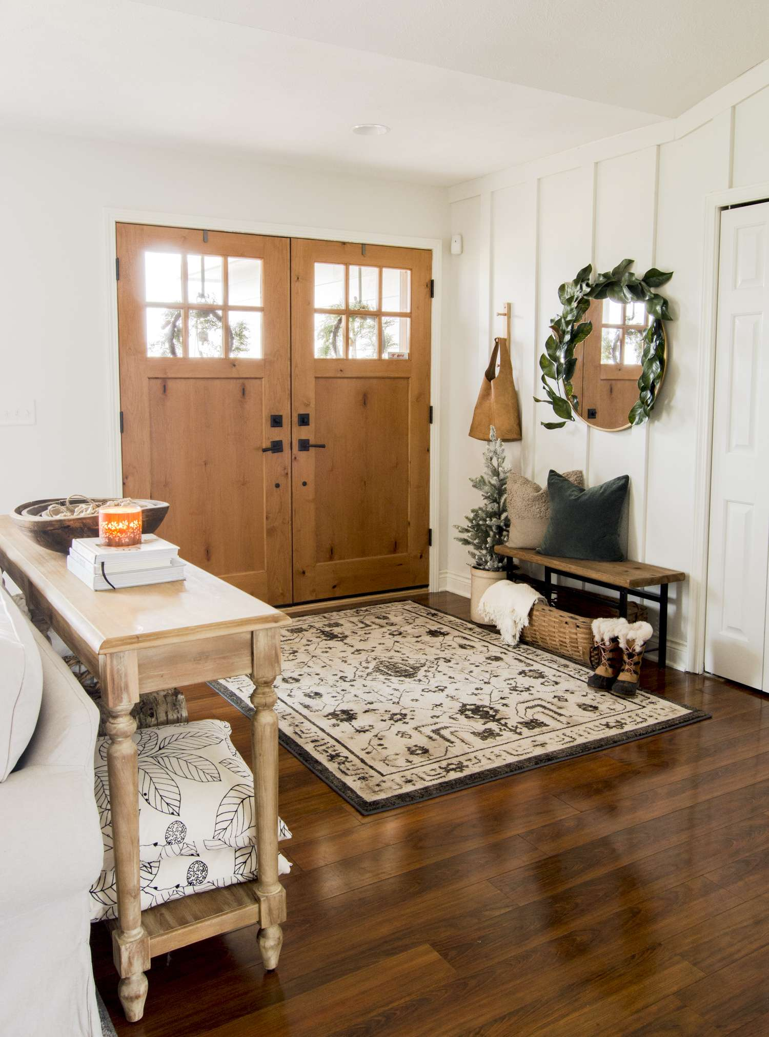Winter decor with a narrow entryway bench.