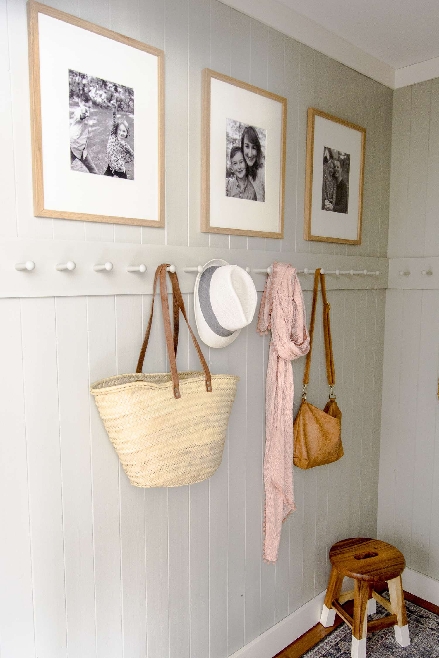 Mudroom design with a peg rack.