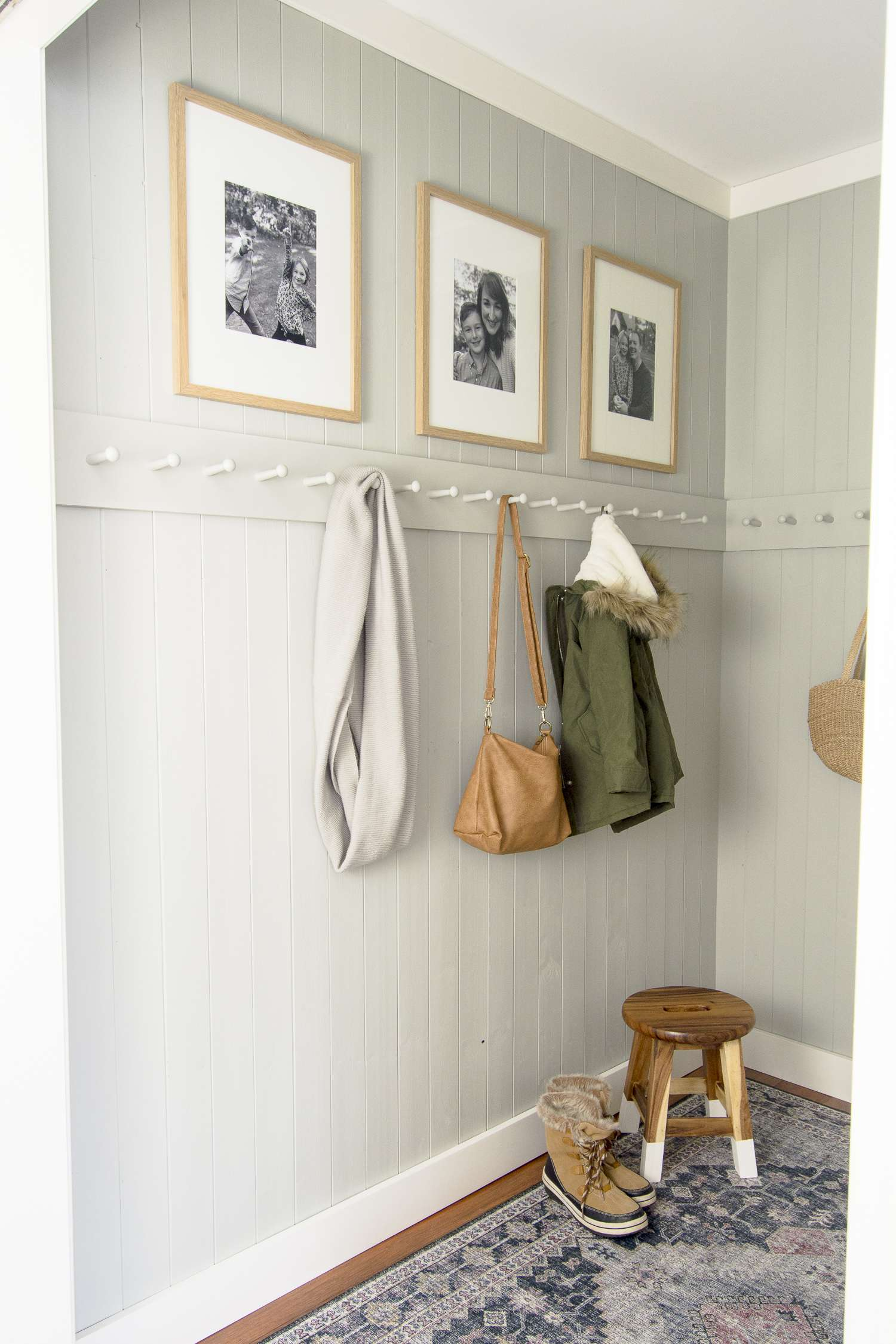 Peg rack in a small mudroom.