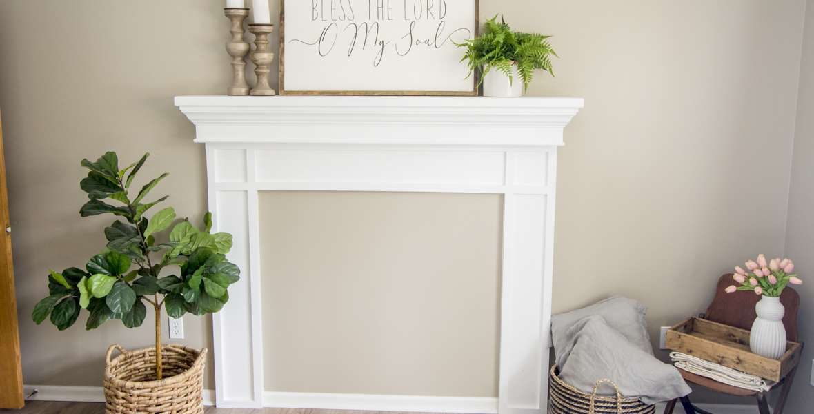 Adding a faux fireplace mantel instantly creates a focal point and cozy atmosphere in a room. Learn how to build a DIY fireplace mantel in any room!