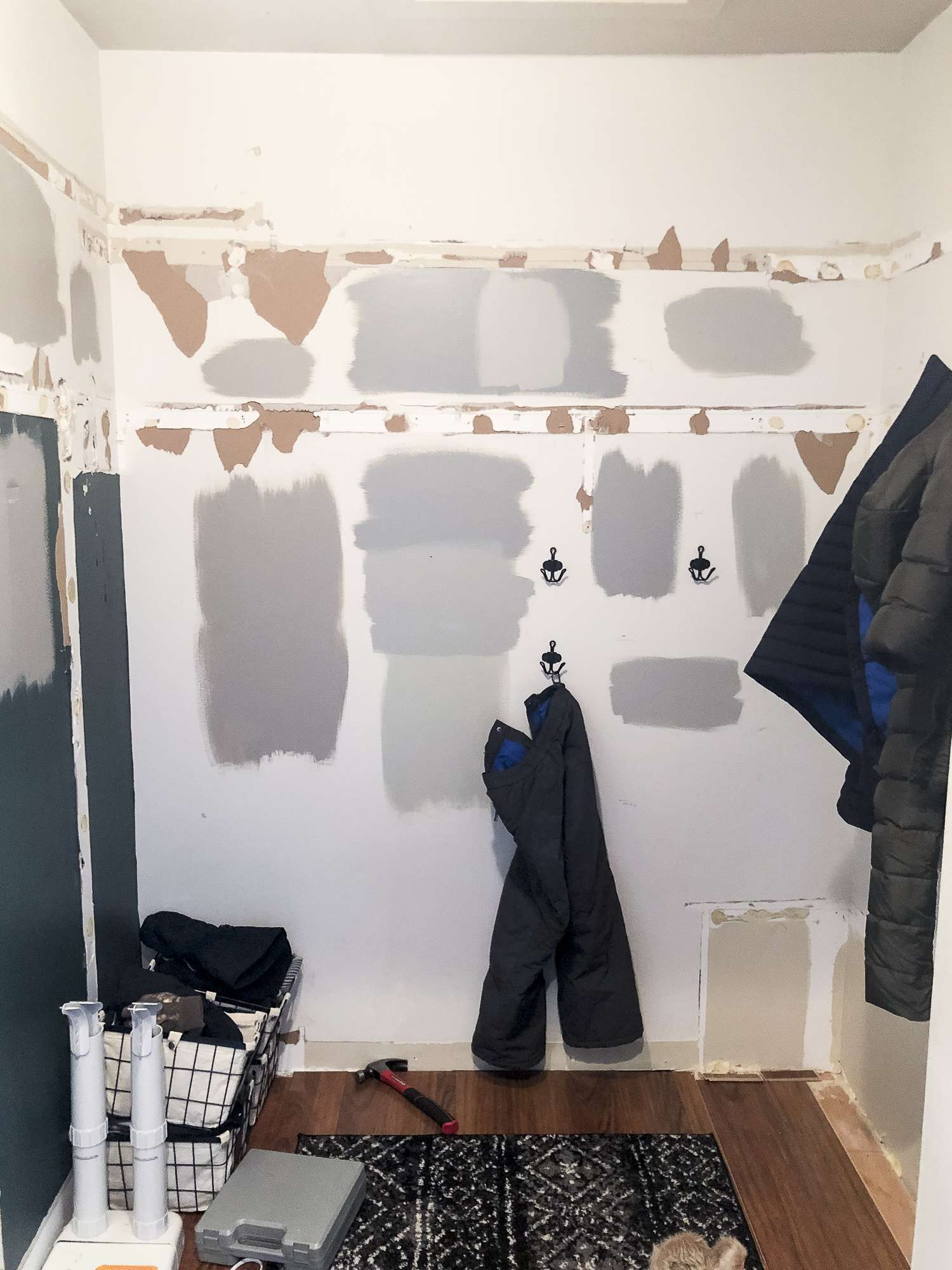 Choosing paint colors in a mudroom design.