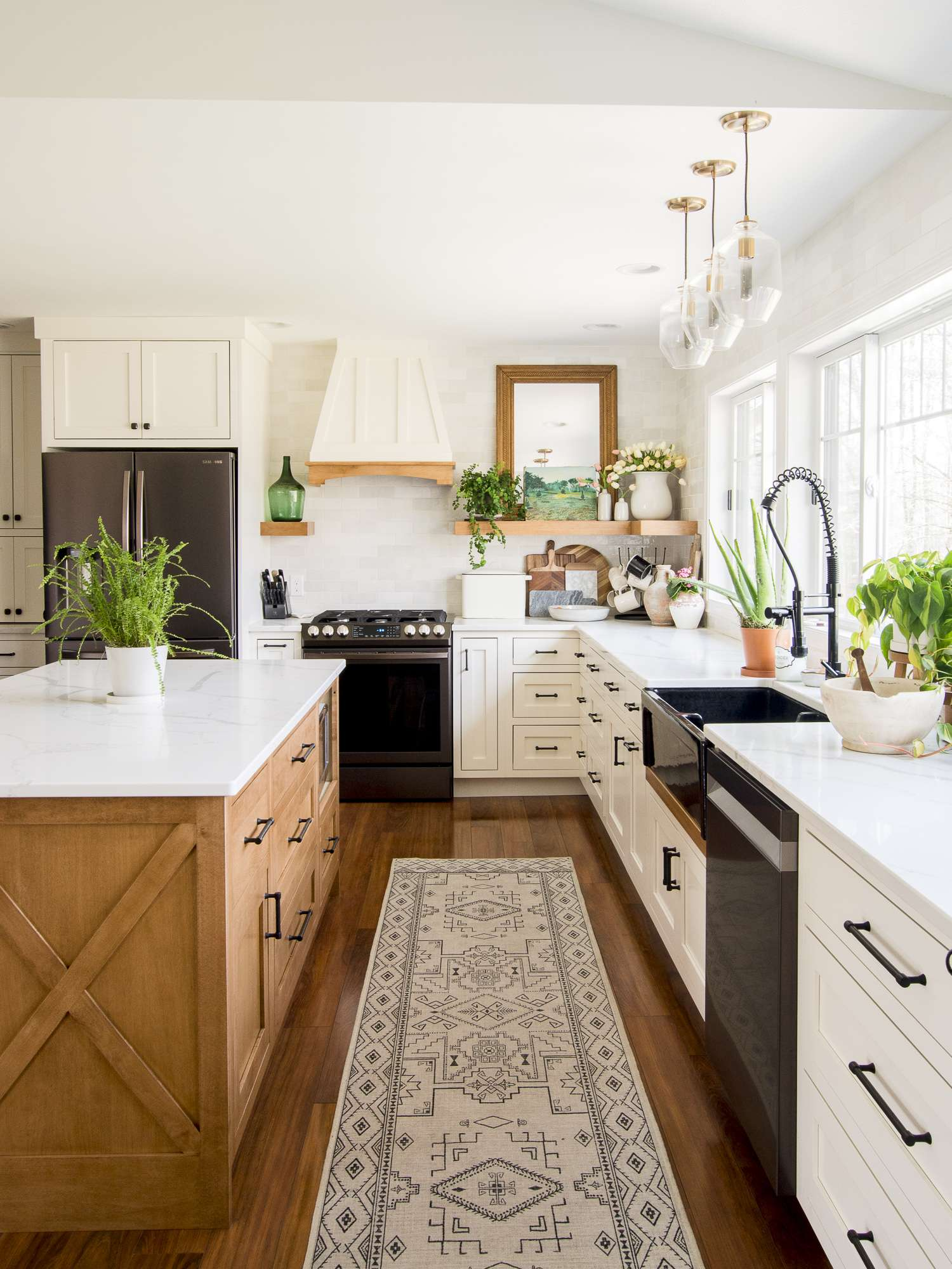 Indoor plant care in a modern farmhouse kitchen.