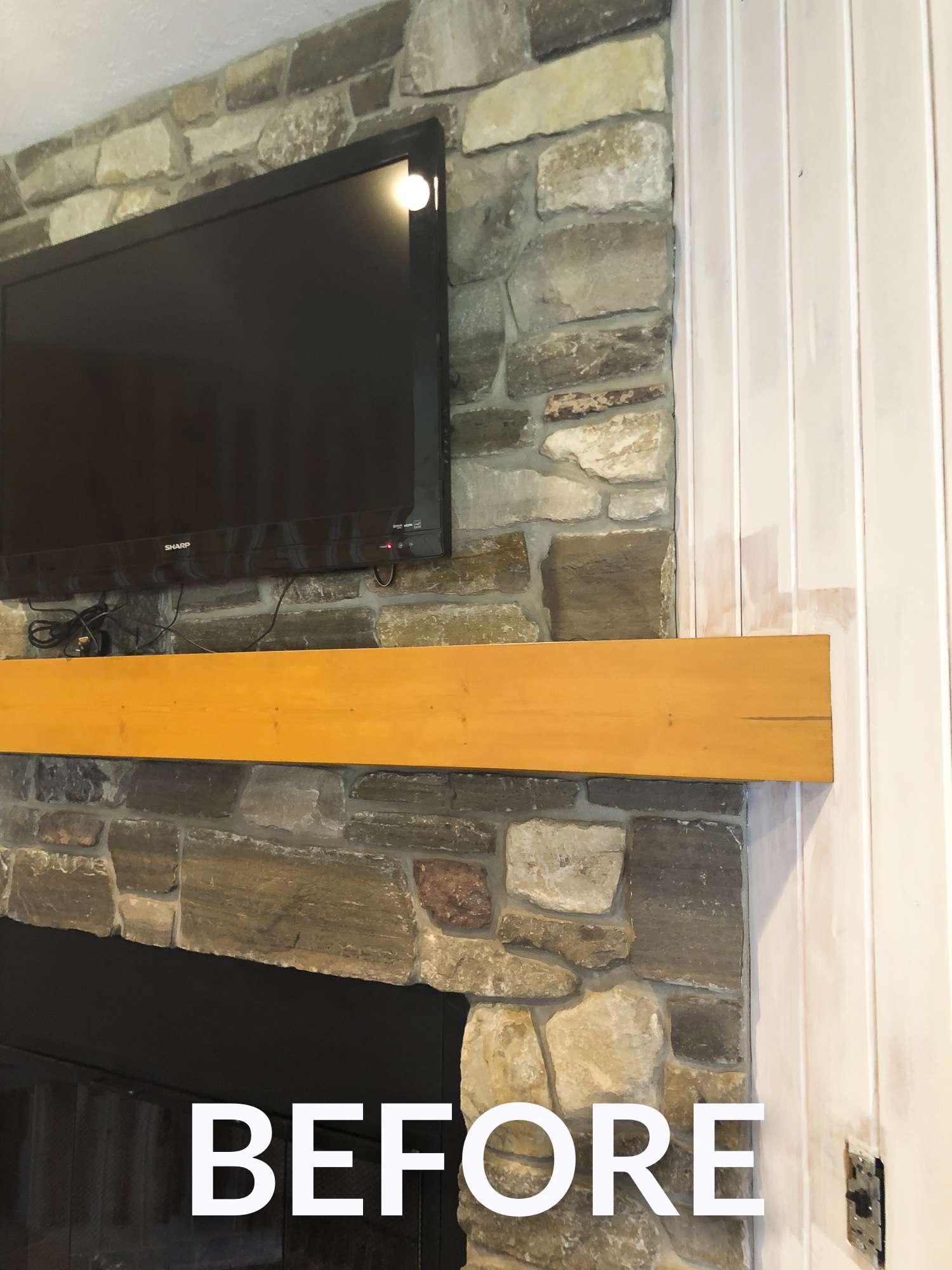 Simple wood mantel.
