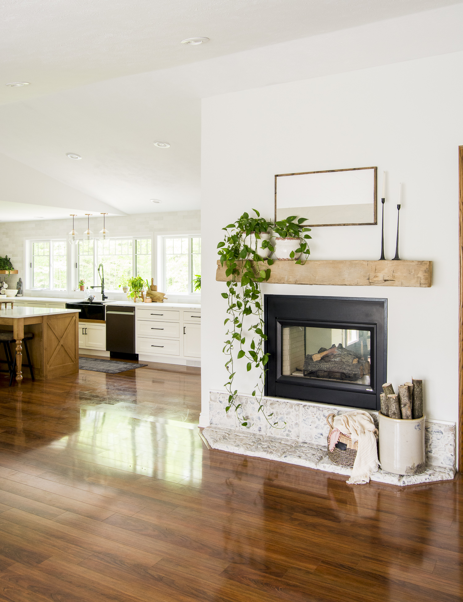 simple summer mantel looking into a kitchen.