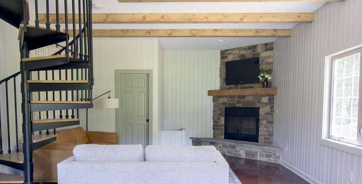 Wood beams are an amazing addition to your home! Learn how to make DIY faux ceiling beams with this simple tutorial as part of our guest house remodel.