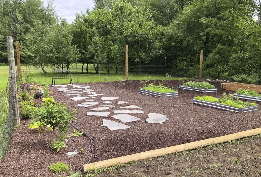 Large garden with raised beds.
