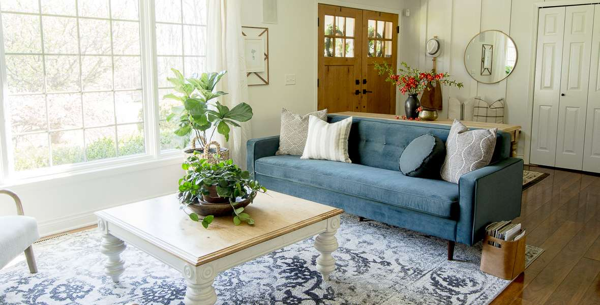 Learn how to get the modern bohemian design style with simple design tricks! Enjoy this summer home tour of my modern boho living room decor.
