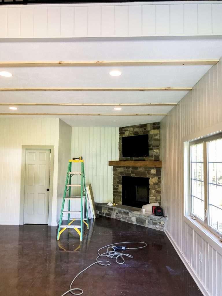 Installing wood beams.