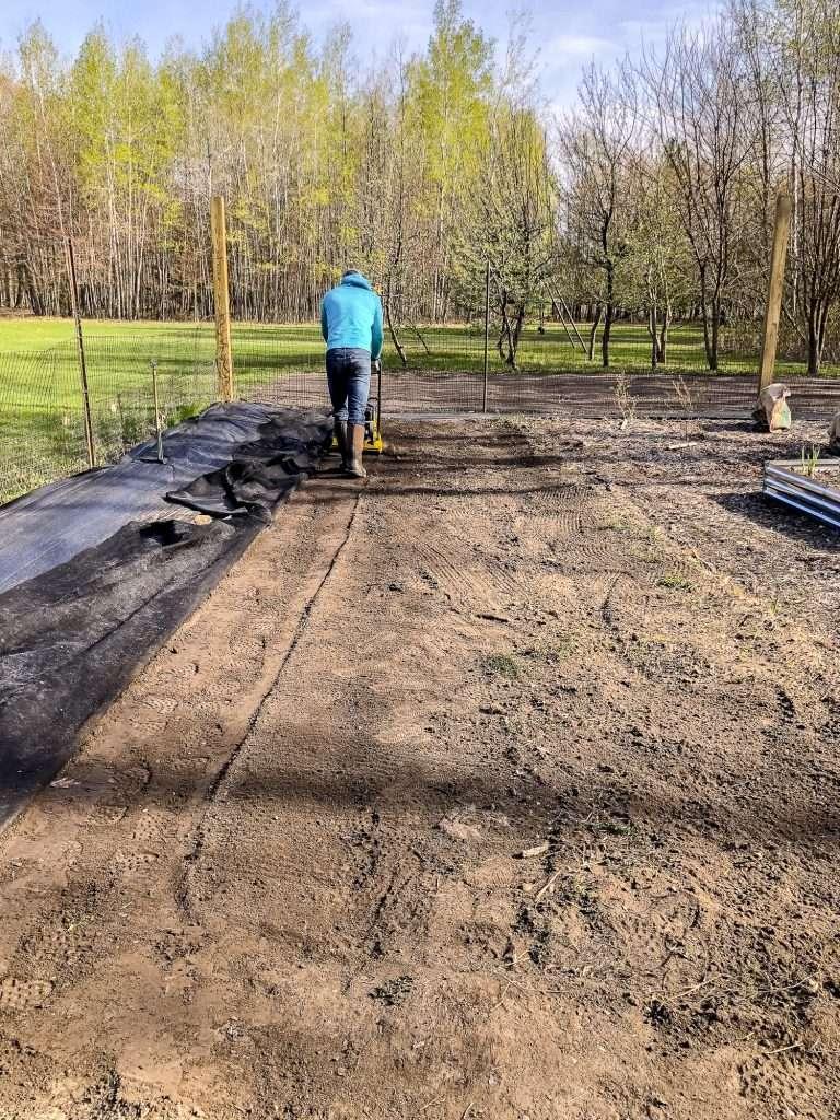 Adding flower bed to a garden.