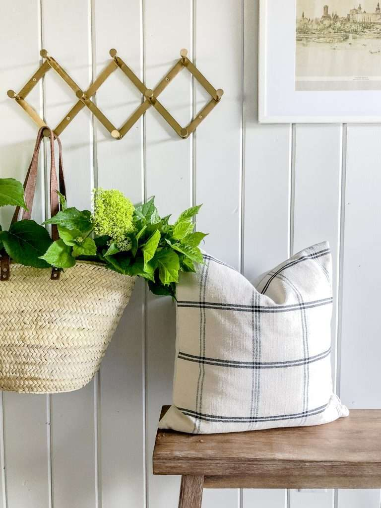 Pillow and basket in an entryway.