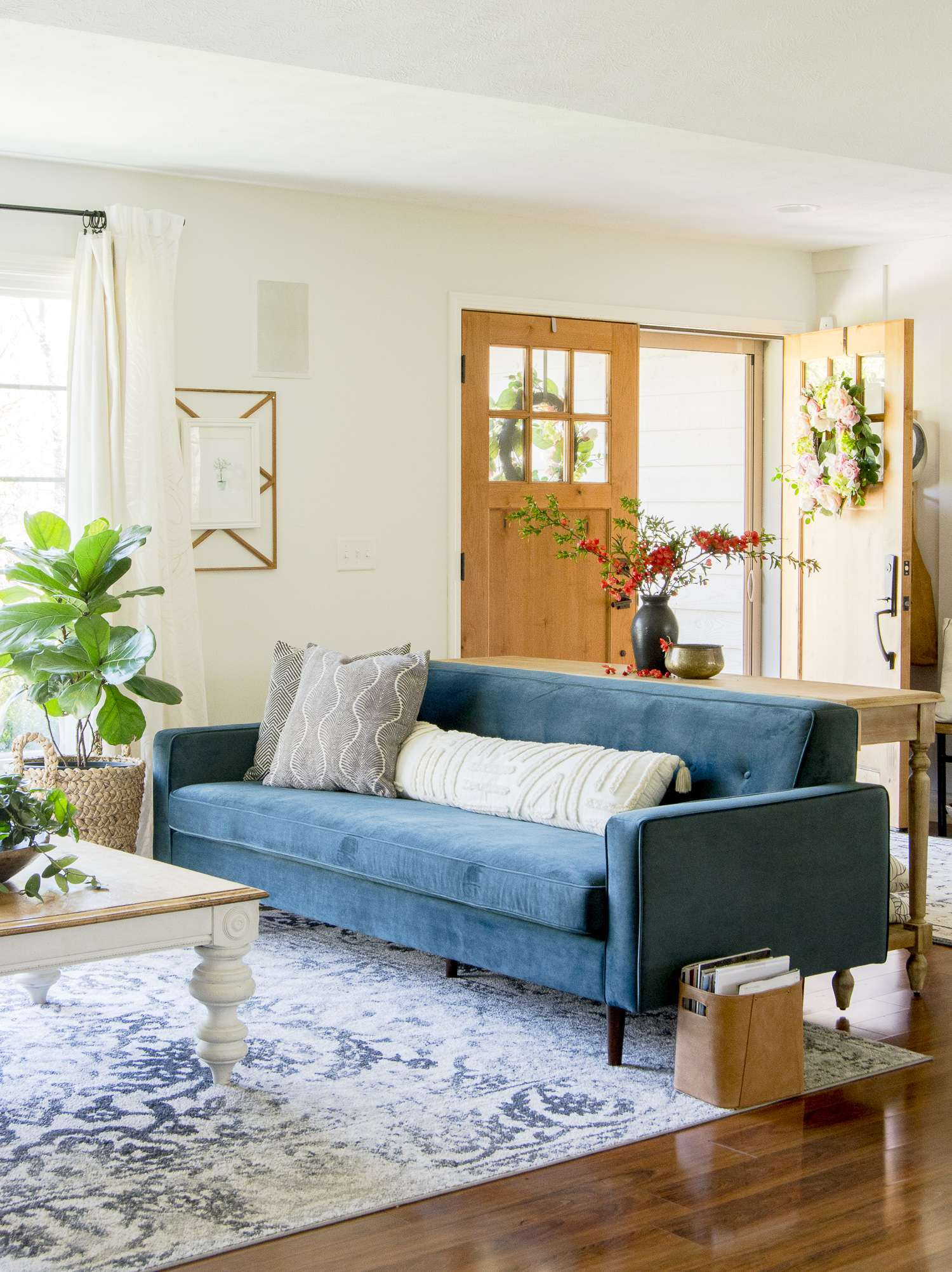 Velvet couch with an open entryway.