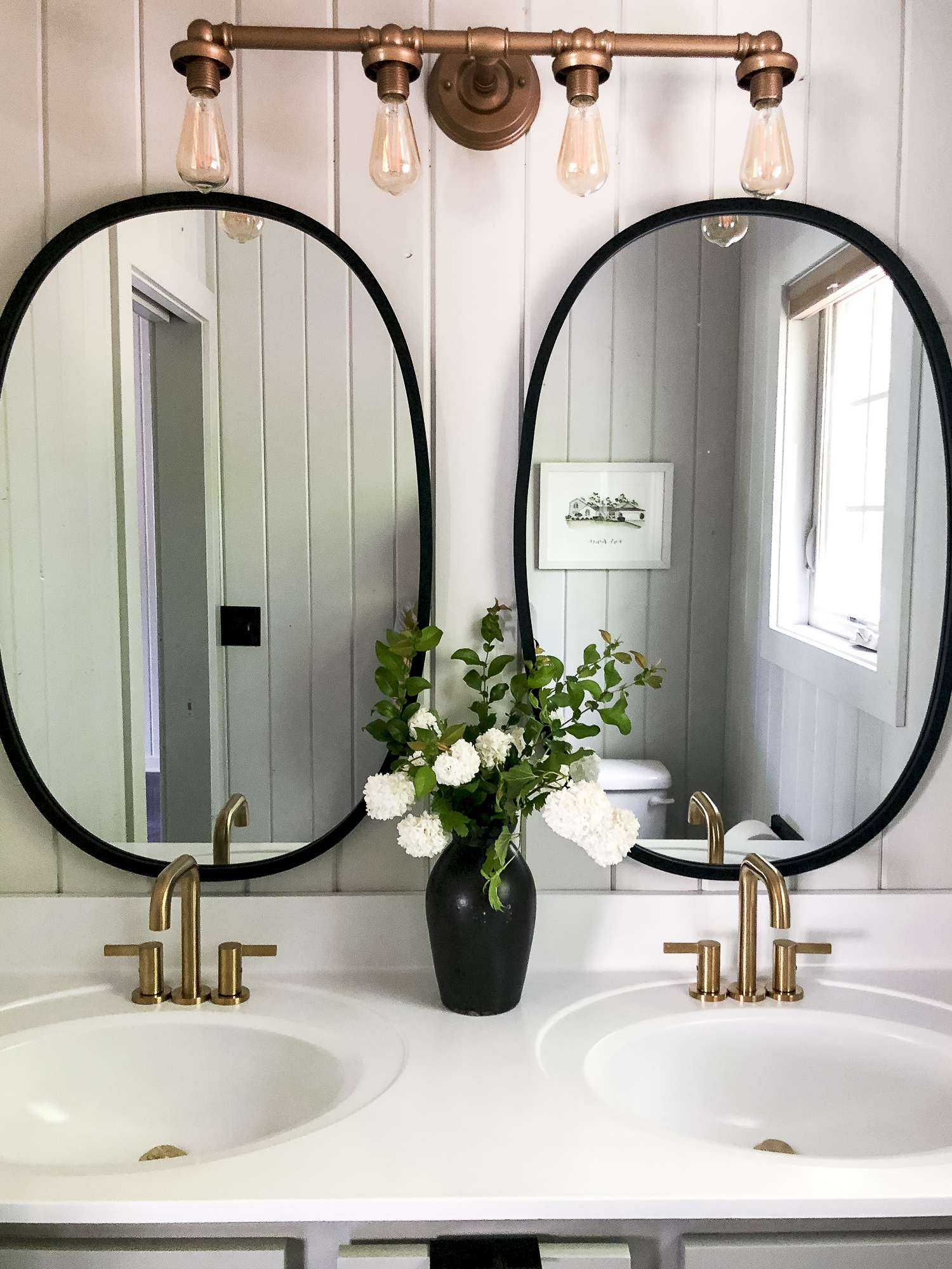 Double mirrors over a budget friendly vanity.